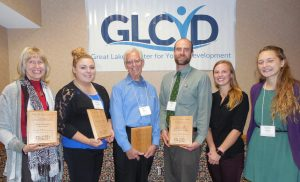 From left are Susan Madden of Marquette, recipient of the award in the adult category; Stephanie LaFoille of Manistique, recipient in the youth category; Del Compton of Marquette, recipient in the senior category; Jon Barch, Katie Pershinske and Georgia Harrison of Student Leader Fellowship Program, recipient in the volunteer program category.